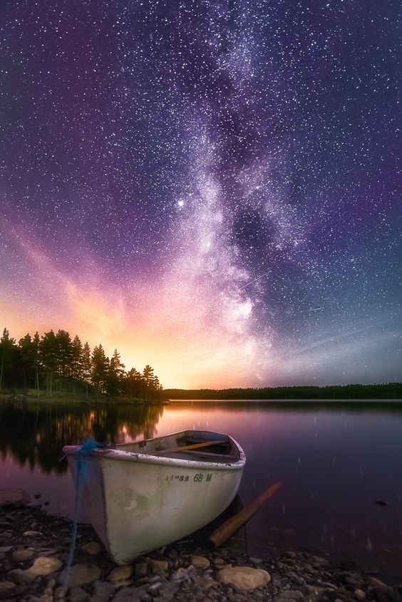 Light in Darkness - A touch of magenta aurora, a milky way and a healthy dose of light pollution.