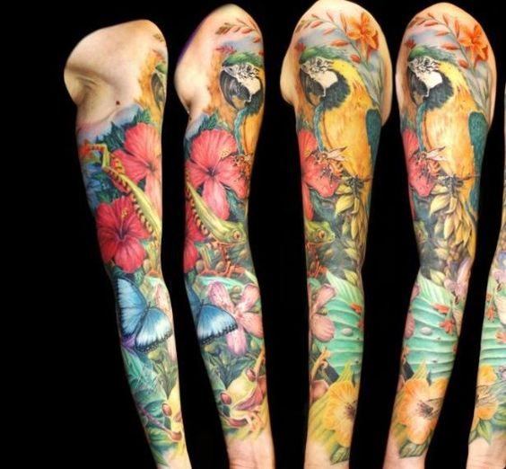 Tropical full sleeve pastel flower tropical tattoo ideas for Tropical themed tattoos