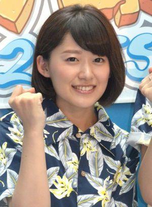 ガッツポーズの尾崎里紗さん