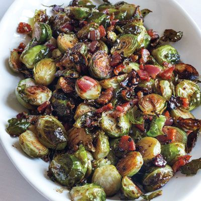 "BALSAMIC-ROASTED BRUSSELS SPROUTS ""We all know boiled brussels sprouts are mushy and horrible,"" says Garten. ""But these roasted ones are more like French fries."" Cut them the day before, then pop the dish into a 400°F oven while the turkey rests. A balsamicvinegar glaze adds a sweet, acidic edge."