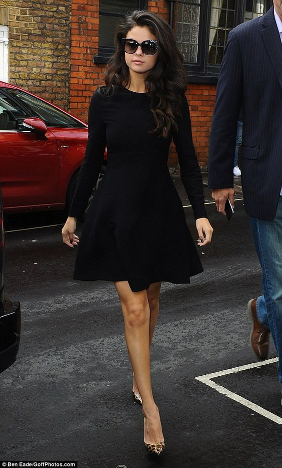 Simply beautiful: On arrival, Gomez donned a black skater frock as she hid her eyes behind a pair of shades