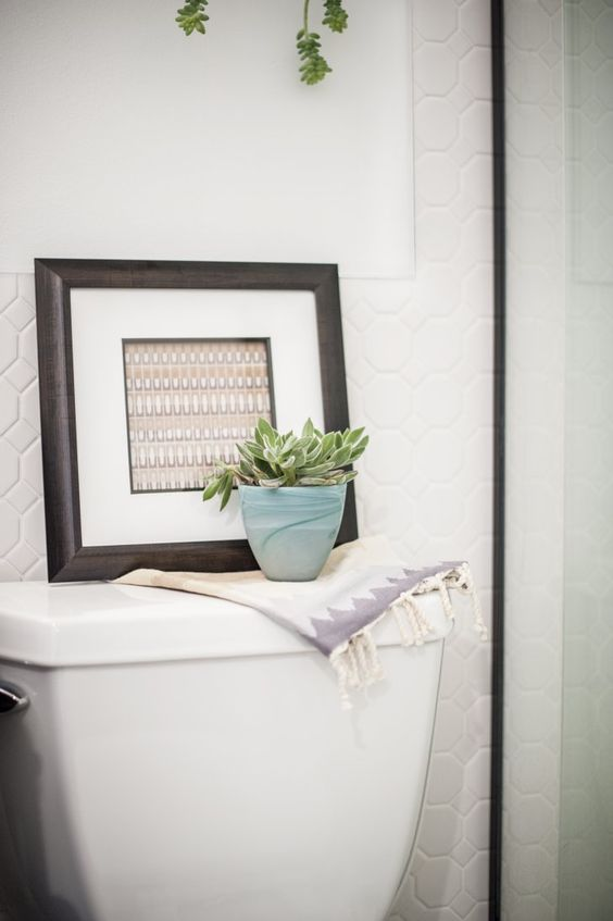 Pin for Later: This Bathroom Renovation Tip Will Save You Time and Money  A closer look at the tile wainscoting.