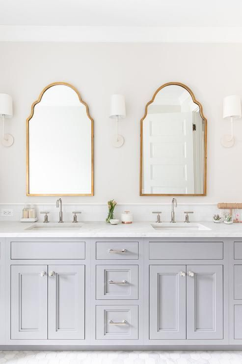 A Gray Double Bath Vanity Sits On Marble Hex Floor Tiles And Is