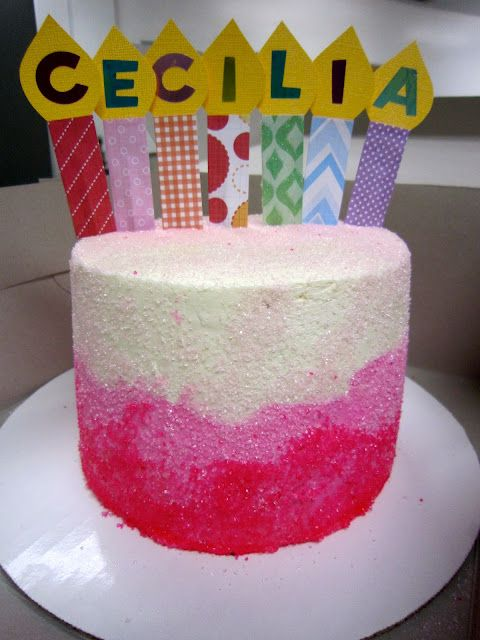 a pink birthday cake for a 4-year old; pink gradient buttercream and pink sanding sugar; personalized handmade topper
