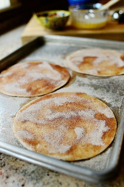 Cinnamon Crisps | The Pioneer Woman 1 stick Butter, Melted 3 whole Flour Tortillas (small Size) 1 cup Sugar 1 Tablespoon Ground Cinnamon INSTRUCTIONS Preheat the oven to 350 degrees.   Mix together the sugar and cinnamon.   Brush butter on one side of the flour tortillas. Sprinkle generously with the cinnamon sugar. Flip tortillas to the other side, then sprinkle on the cinnamon sugar.   Bake for 15-17 minutes until very crisp. Remove from oven and allow to cool completely.