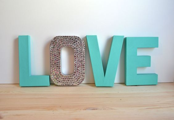 Wood letters, paint color of your choice, modge podge and rhinestones or glitter. The word possibilities are endless! Would be so cute for a  nursery with baby's name on the wall.