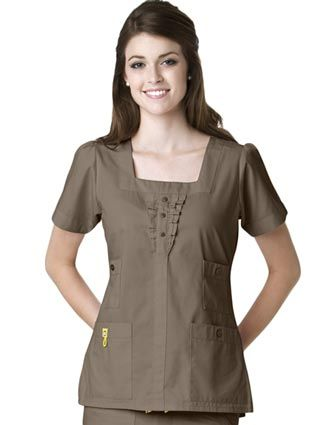 Style Code: (WI-6403)  This scrub top has banded neck, sleeves and center front. It has banded pocket openings with decorative buttons and three front mini decorative buttons. It has also partial elastic at back waist and sIgnature ID bungee loop.
