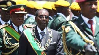 Image copyright                  AP                  Image caption                                      Mr Mugabe says the law offers redress for the colonial era                                Zimbabwean President Robert Mugabe has announced plans to water down a contentious law obliging foreign companies to hand over most of their shares to black Zimbabweans.