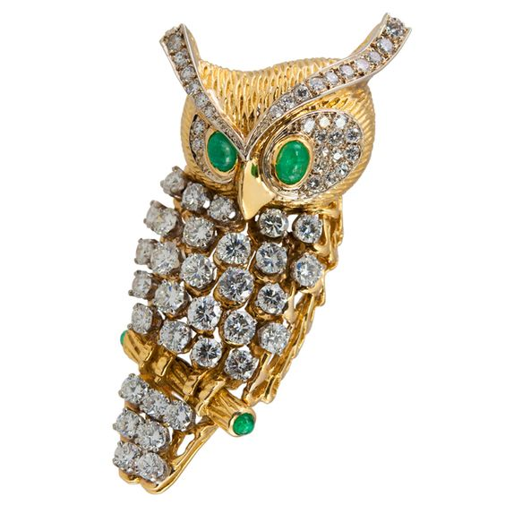 CARTIER Owl Clip.This handsome fellow is covered with 4 carats of diamonds, with cabachon emerald eyes and on the ends of his perch.Ca. 1950s-60s