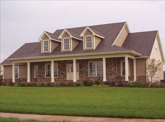 Lovely dormers and front porch give this country home a Dormer house plans