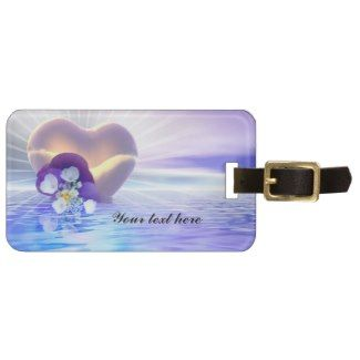 Honeymoon luggage tag with romantic flowers floating on the ocean