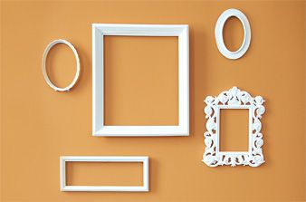 Unify mismatched frames with white paint. #decor