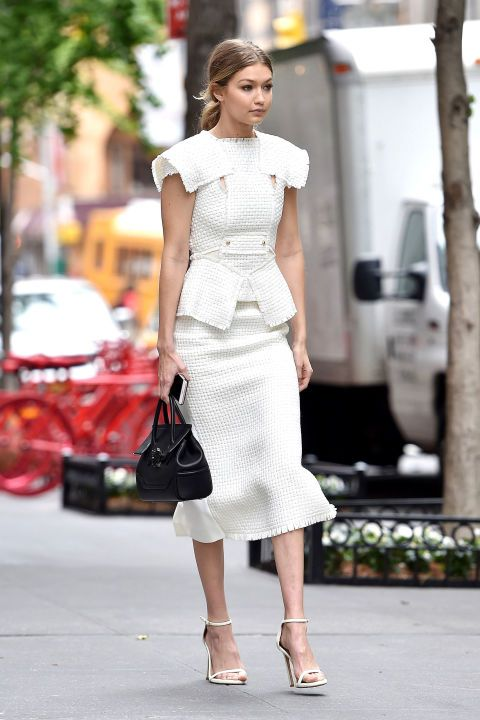 Traipsing around NYC, Hadid was the epitome of elegance in a tailored white Roland Mouret top and skirt, paired with matching strappy Stuart Weitzman sandals.