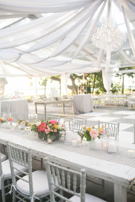 draped clear top tent with a chandelier | Courtney Dox