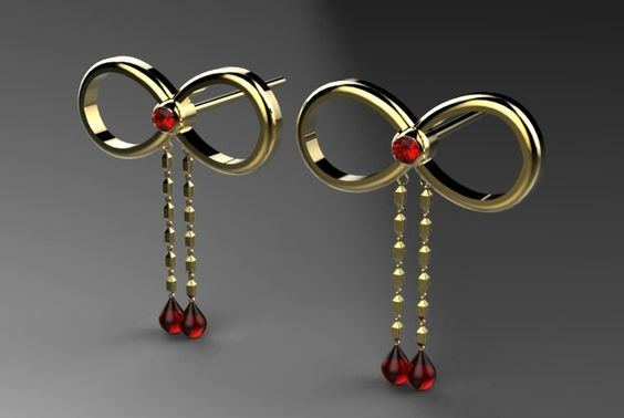 A pair of cute gold and garnet bow studs