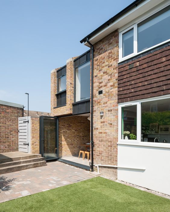 Re-imagining a 1960's terraced house with 2 storey side extension with brick gable walls by Selencky///Parsons. Photo by Andy Matthews