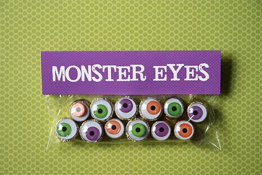 super cute monster eyes.. rolos and googly eyes. perfect.  These would be cute cookies too.