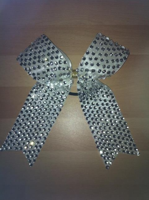 sarah makes the most amazing bows for cheerleading and dance groups! Wish my hair was long enough for one of these beauties! http://www.facebook.com/pages/Snazzy-Bows/172956369417048