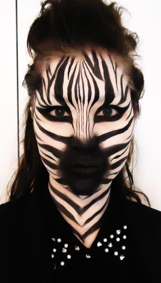Zebra Products used: · Mac Pure White Chromacake · Makeup sponge · Mac Carbon matte eyeshadow · Mac Blacktrack fluidline · Mac Black Black Acrylic Paint · Br...