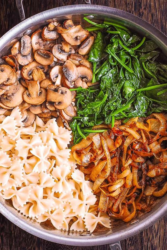 Creamy Farfalle Pasta with Spinach, Mushrooms, and Caramelized Onions