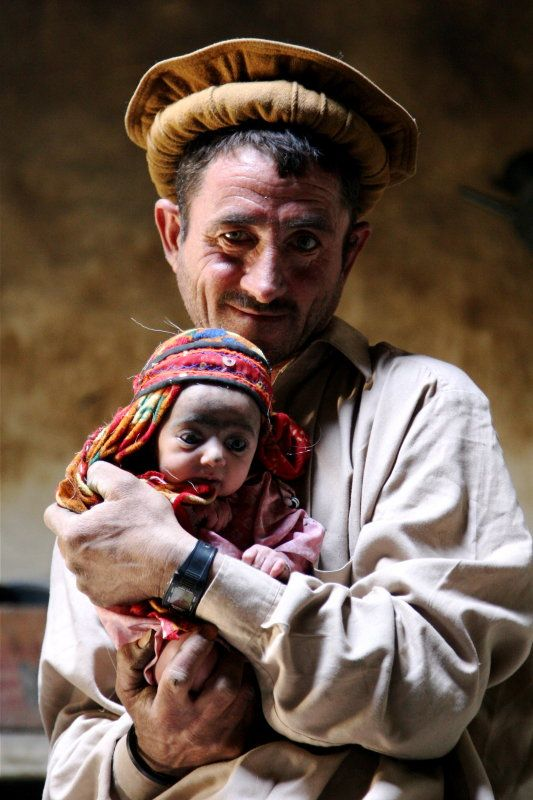 Wakhi Father and Child, Afghanistan. The Wakhi people are an ethnic group originating in the Wakhan of today's Badakhshan region located in northeastern Afghanistan and southeastern Tajikistan.