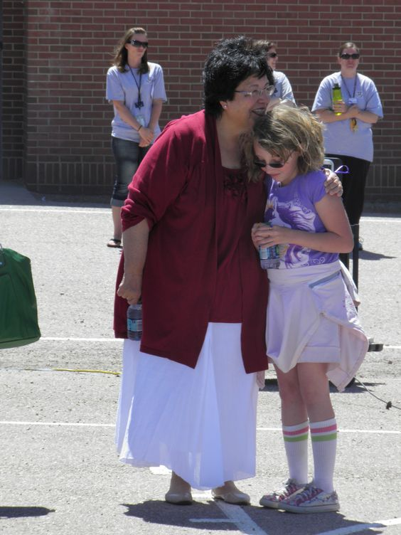 "Third grader Alexandra Miskie, 8, stands with her grandmother, Sandra Miskie, a 20-year cancer survivor, May 3, before an American Cancer Society Relay Recess at Stetson Elementary School. Alexandria Miskie's paternal grandmother died of breast and lung cancer. Sandra Miskie had also been diagnosed with terminal cancer, and given a two-week life expectancy. ""If I didn't fight 20 years ago,"" she said, walking with her family during the relay, ""I wouldn't have been here to see my…"