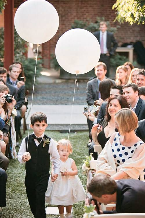 Balloons as Wedding Decor Held by Flower Girl and Ring Bearer