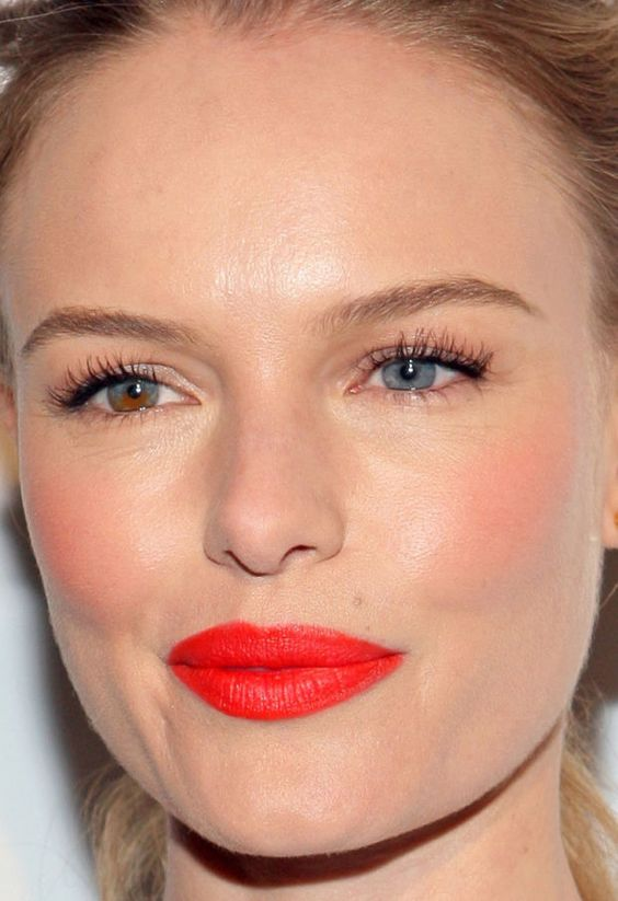 Kate Bosworth's vivid red-orange lips with matching cheeks