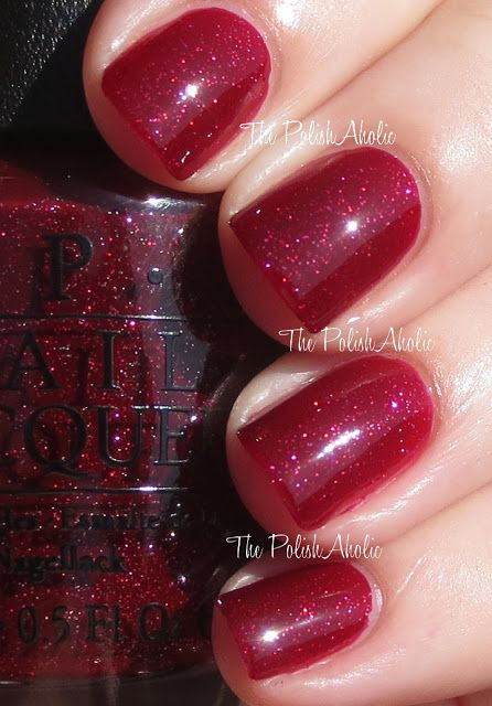 OPI Underneath The Mistletoe is a red jelly base loaded with glitter.