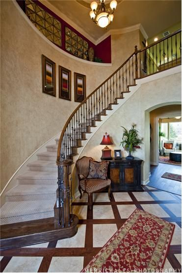 Formal Staircase Design Perfect For Welcoming Guests Into