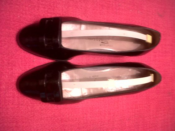 Black patent leather shoes with brooch. Salvatore Ferragamo