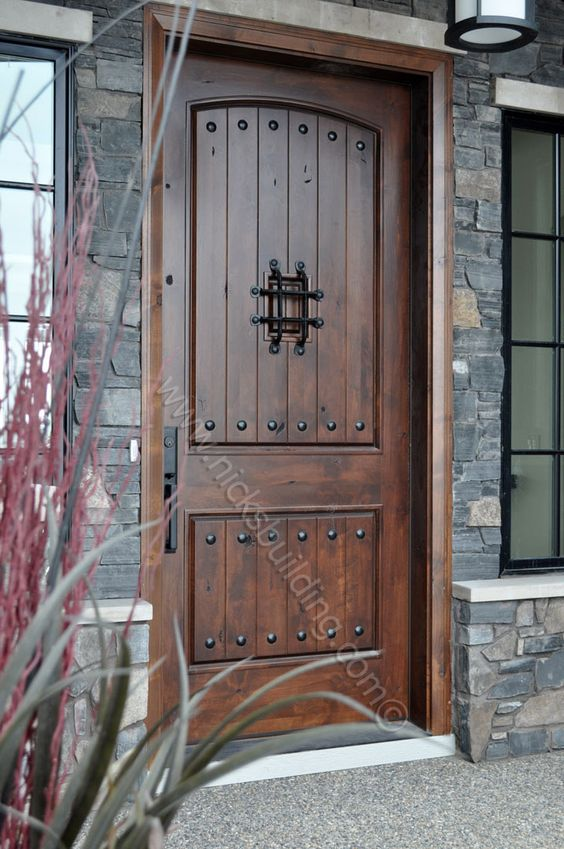 Rustic door knotty alder door door with wrought iron for Knotty alder wood doors