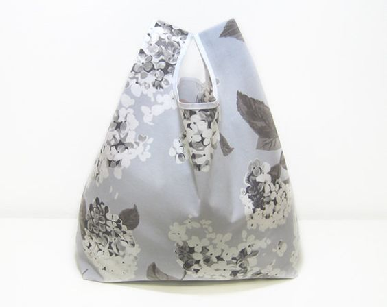 Reusable Shopping Bag, folded into a triangle, gray and white flowers cotton, edged in white ribbon.. €15.00, via Etsy.