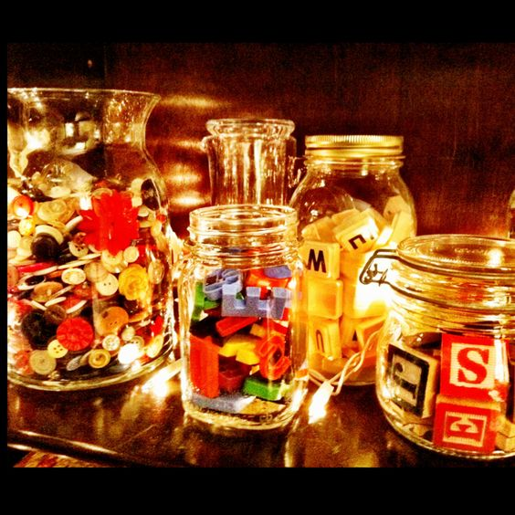 Buttons, game pieces, treasure... With pretty jars <3: