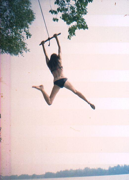 summers swinging over water