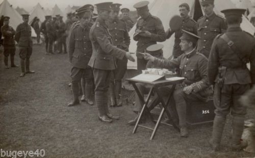 Soldier-Group-5th-Battalion-Northumberland-Fusiliers-being-issued-with-Pay