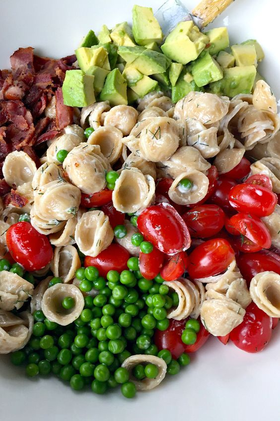 This Summer Avocado Pasta Salad is perfect for any picnic, lunch, dinner, or a Memorial Day or Fourth of July potluck dish.: