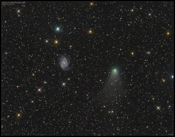 "Comet C/2012 V2 LINEAR and the bright spiral galaxy NGC 2997 in Antlia on September 29, 2013. They look close together, but the galaxy is 38 million light years away. (Credit & copyright: Damian Peach) Mona Evans, ""Comets"" http://www.bellaonline.com/articles/art33712.asp"