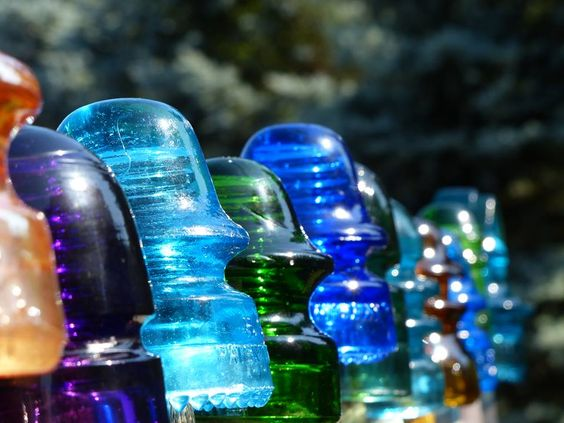 Antique glass antiques and glasses on pinterest for Glass telephone pole insulators