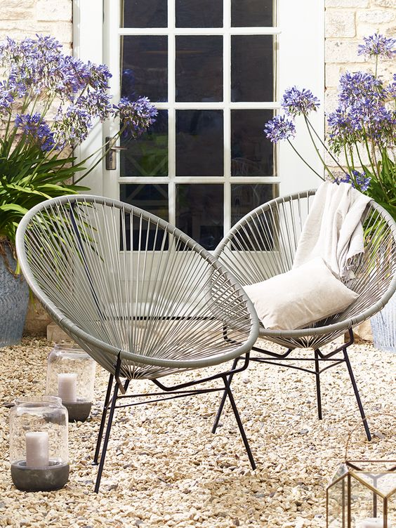Inspired by 1950's Acapulco chairs, our classic string chair has been woven from high quality durable plastic around a strong metal frame. Each chair has been designed for optimum comfort with a cocoon shape centre and high back. Ideal for outdoor lounging during the Summer months, this large soft grey chair will also add a contemporary twist to your inside space.
