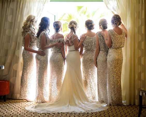 The perfect last dressing room memory, this moment is a metaphorical adieu before your girls send you off to your groom. Looking out the window symbolizes looking to the future ahead —or it can just be a way to spy on guests as they arrive.