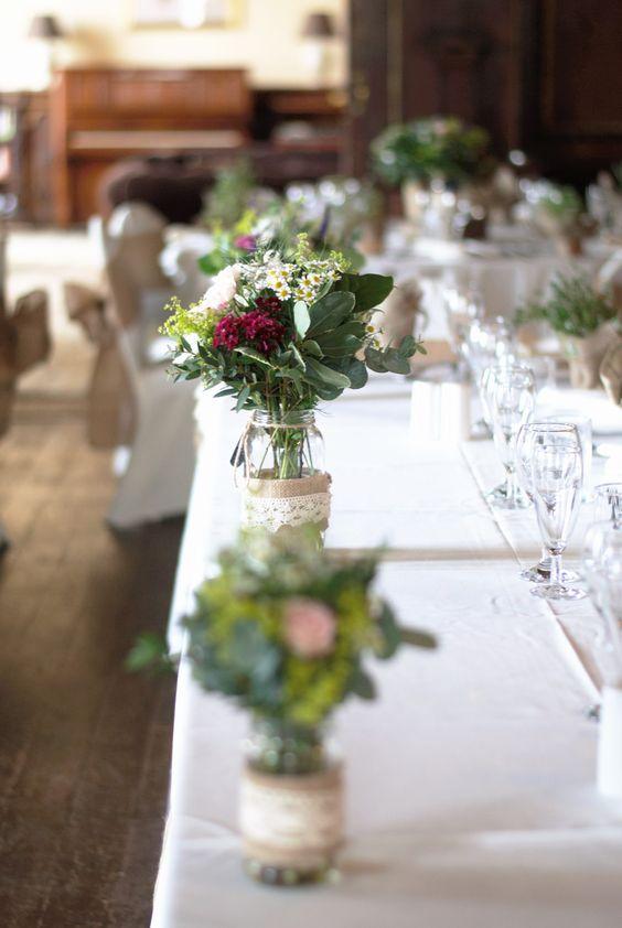 Wild flower posies on the table at an East Dene Wedding  www.eastdeneiow.co.uk