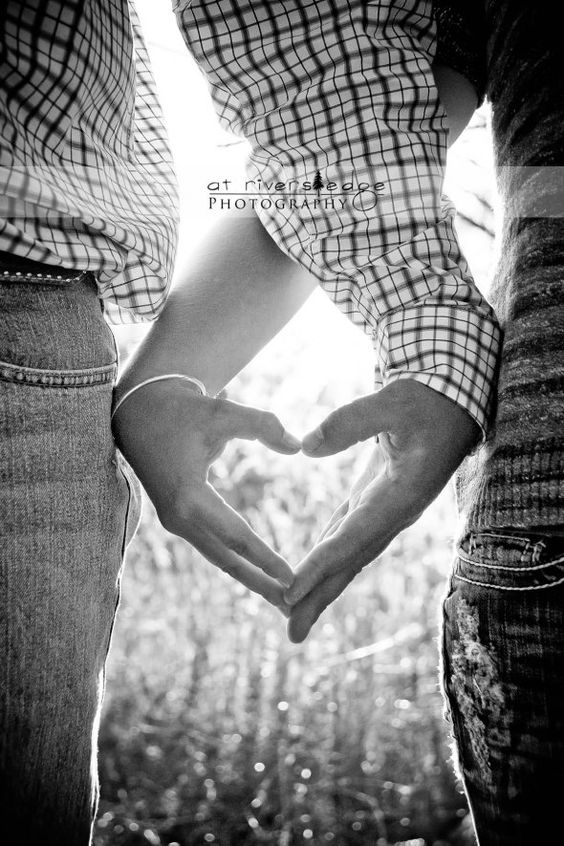 backlit heart shaped hands save the date photo by Rivers Edge Photography