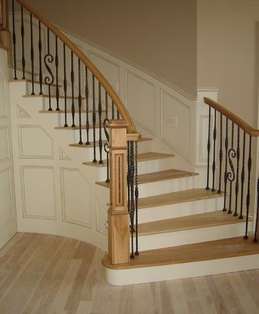 curved oak staircase with wrought iron railings diy