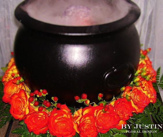 Halloween witch cauldron centerpiece Halloween decorating idea with roses