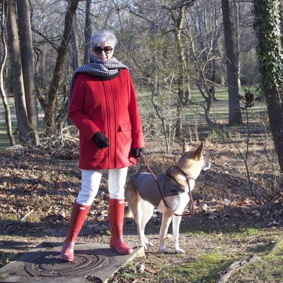 red stadium coat, striped crewneck, white denim, red hunter boots, houndstooth cashmere scarf