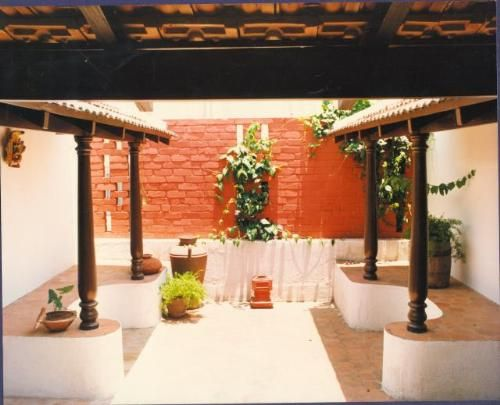 Wooden pillars  Courtyards and Mangalore on PinterestA small     chettinad     type of courtyard on the first floor of the Dr
