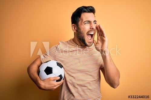 Handsome Player Man With Beard Playing Soccer Holding Footballl Ball Over Yellow Background Shouting And Screaming Loud In 2020 Yellow Background Bearded Men Handsome