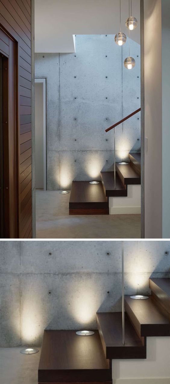 7 Interiors That Use Dramatic Uplighting To Brighten A Space // Embedded lights guide people up the stairs in this home, and add both style and safety elements to the staircase.