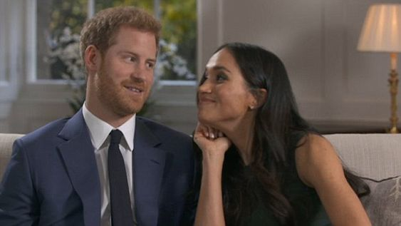Prince Harry and Meghan Markle goof around after they finish their first interview after announcing their engagement.